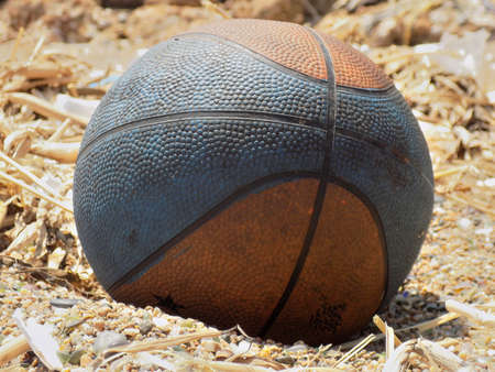 deflated: A dirty and deflated ball has been taken in the sand. Stock Photo