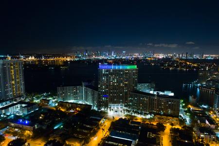 MIAMI BEACH, FL, USA - OCTOBER 9, 2017: Aerial drone shot of the Flamingo Towers Condominium MIami Beach at night