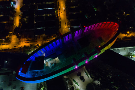 Aerial image of a building roof lit in neon rainbow colors Stok Fotoğraf