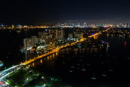 Aerial night photo Miami Beach Belle Isle condominium buildings and Venetian Stok Fotoğraf