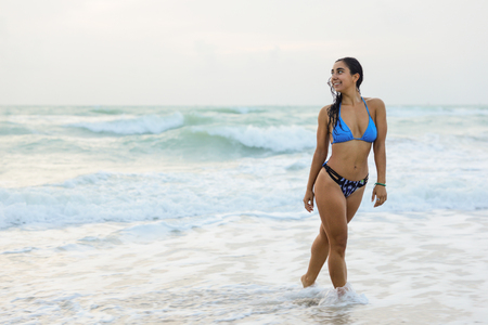 Woman getting out of the water and smiling over her shoulder Stok Fotoğraf
