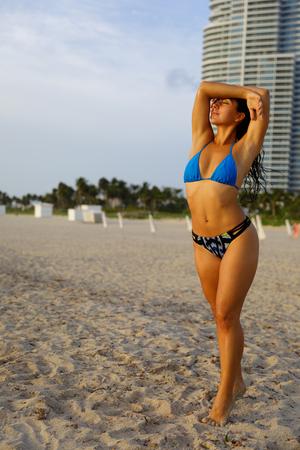 Stock photo of a sexy young bikini model posing on the beach