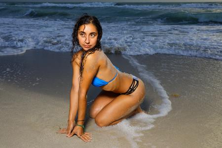 Image of a beautiful bikini model posing on the beach Stok Fotoğraf