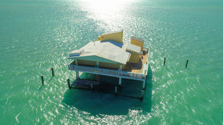 Aerial image of abandoned homes on stilts in Miami Florida