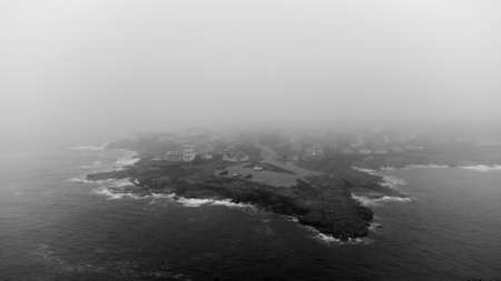 Aerial drone photo of York Maine USA black and white foggy weather