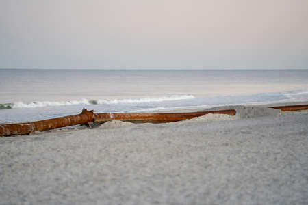 Pipes laying on the beach restoration project coastal USA