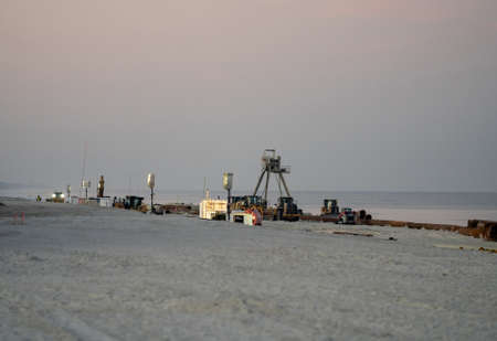 Beach restoration project pumping sand to expand shoreline