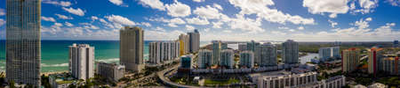 Aerial panorama Sunny Isles Beach facing south at 163rd Street highrise beachfront condominiums in photo