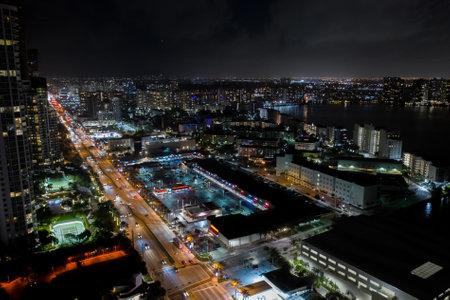 Shopping plaza strip mall night aerial photo