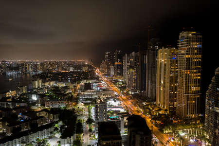 Night aerial photo Sunny Isles Beach FL city lights