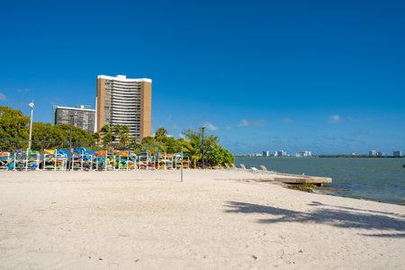 Miami Beach scene with kayak storage on the sand