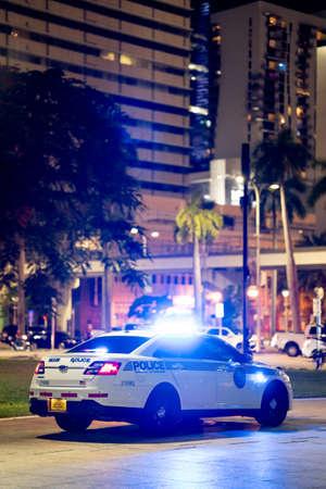 Miami, FL, USA - July 9, 2021: Miami Dade police car on patrol with lights