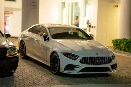 Miami, FL, USA - July 10, 2021: Photo of a sleek new Mercedes sedan parked in the city at night