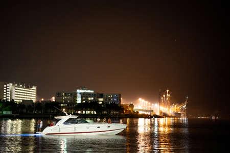 Miami, FL, USA - July 9, 2021: People having a party on a boat Miami scene Publikacyjne