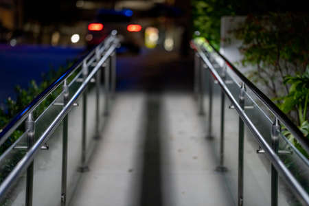 Metal handrail leading to an office building