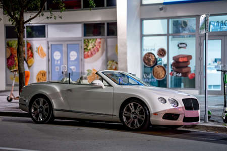 Miami, FL, USA - July 9, 2021: Night photo of a white Bentley GT V8 Convertible parked at Downtown Brickell Miami Publikacyjne