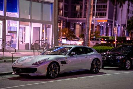Miami, FL, USA - July 9, 2021: Silver Ferrari Portofino parked in a city street at night