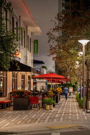 Miami, FL, USA - July 9, 2021: Night scene at Mary Brickell Village Miami FL a nightlife scene