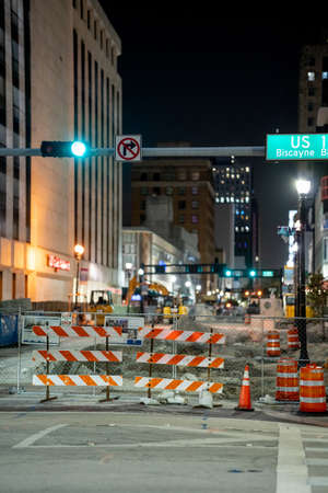 Miami, FL, USA - July 9, 2021: Flagler Street Downtown Miami construction night photo Publikacyjne