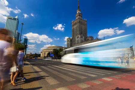 Palace of Culture and Science with a crosswalk in the foreground. It is the center for various companies, public institutions and cultural activities and authorities of the Polish Academy of Sciences