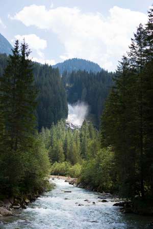 Krimmler waterfalls in the Tyrolean Alps in the sunshine from afar