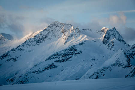 Tyrolean mountain landscape during the sunrise with snow covered mountains.