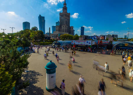 Warsaw, Poland. Palace of Culture with metro entrance and Science and downtown business skyscrapers, city center.