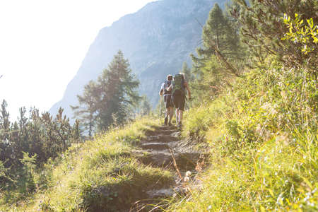 Friends are hiking in summer mountains, Austria 写真素材