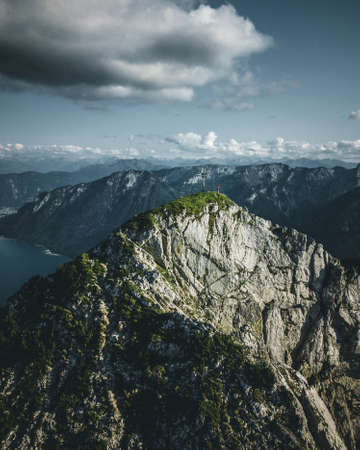 Mountaineer enjoying the view over lake Achensee in summer, Austria Tyrol
