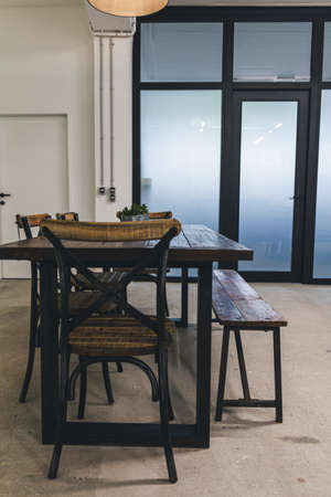 Dining room of a modern office with industrial tables and chairs