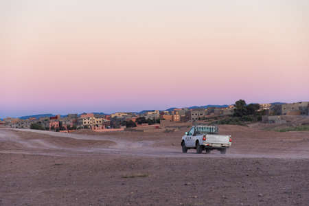 Pick-up van going to a village at sunset in Morocco
