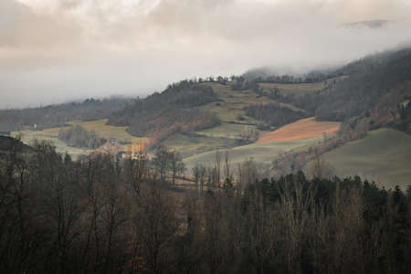 Tuscany's typical hills and fields during a cold winter morning