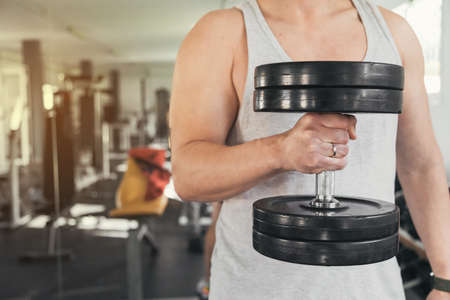 Man holding dumbbells.health and well-being concept.
