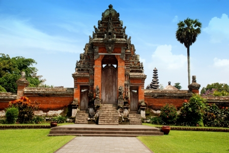Main entrance of Taman Ayun Temple in Mengwi (Bali, Indonesia) on a beautiful sunny day. Originally dated from 1634, Taman Ayun has been restored and enlarged in 1937.