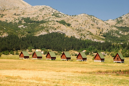 ecotourism: Summer landscape with wooden huts for ecotourism in mountains(Montenegro)