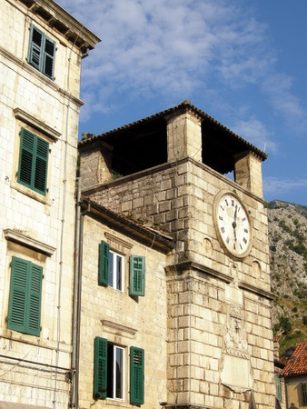 View of medieval clock tower, houses and surrounding mountains, Kotor, Montenegro photo