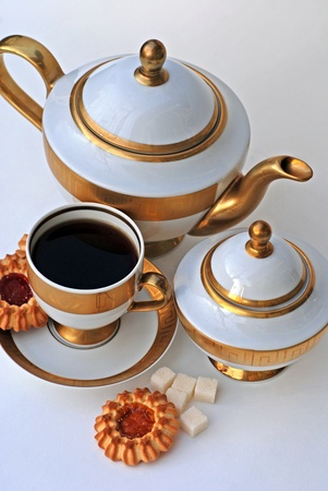 Vertical image with elegant tea service and cookies photo