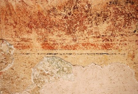 Colorful grunge fresco painted tuscany wall background  Stock Photo