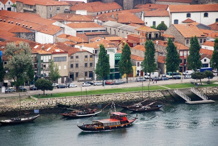 barrel tile: Rabelo Boats in Douro River and old house of Porto , Portugal  Stock Photo