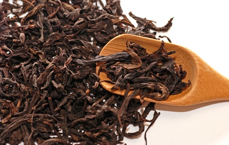 Dried chinese black tea leaves with teaspoon. Stock Photo