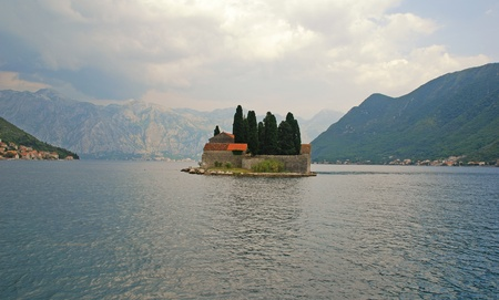 Beautiful landscape with mountains, sea and ancient village on island in Kotor bay(Montenegro) photo