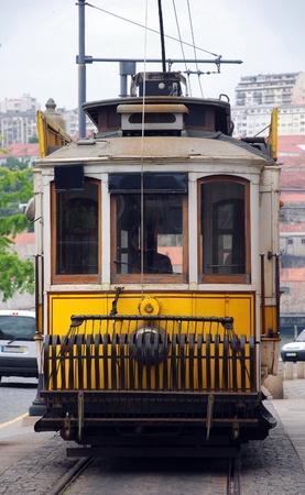 baixa: Traditional portuguese yellow tram and railroad (Portugal) Editorial