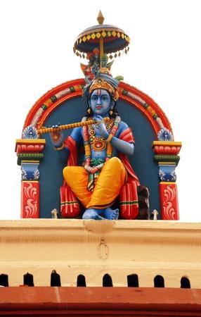 Close up of statue of Hindu deity at Sri Mariamman Hindu Temple in Singapore.  photo