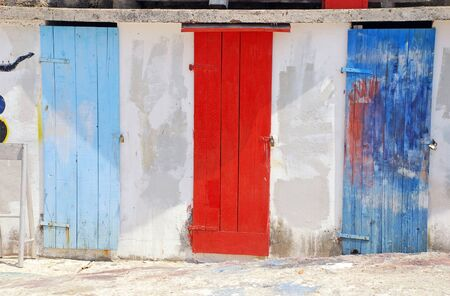 many doors: Three ancient multicolored run-down mediterranean doors (Montenegro)