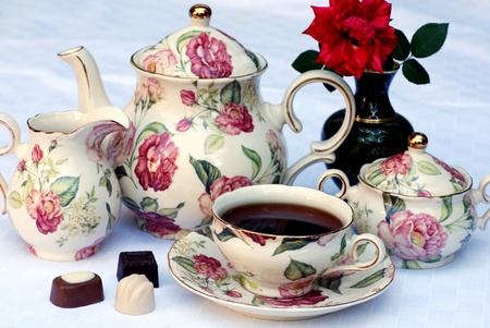 Traditional english tea with floral dishware and rose.Selective focus