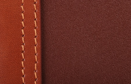 Two-coloured brown leather background with stitching detail. Stock Photo