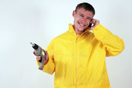 worker in yellow uniform speak phone and smiling photo