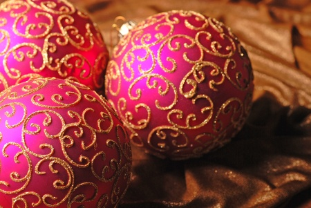 Christmas ball on a shine background. Selective focus. photo