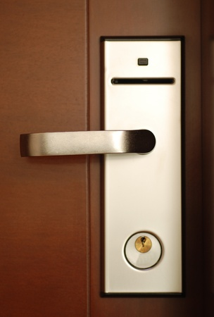 Hotel door handle with security lock Stock Photo