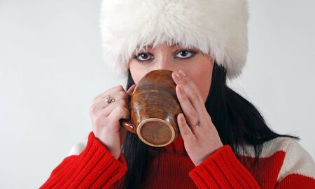 young girl in fluffy hat with hot drink Stock Photo - 10920417